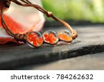 Small photo of Hand made bracelet with flowers decoration in the transparent acrylic resin