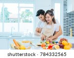 couple making vegetables and... | Shutterstock . vector #784332565
