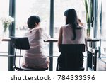 two young woman chatting in a... | Shutterstock . vector #784333396