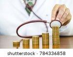 doctor hand holding stethoscope ...   Shutterstock . vector #784336858