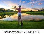 a woman golf player in an... | Shutterstock . vector #784341712