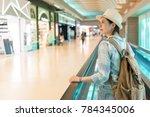 beautiful asian woman walking... | Shutterstock . vector #784345006