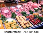 raw meat in butcher's shop... | Shutterstock . vector #784404538