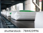 white bag on conveyor line in... | Shutterstock . vector #784423996