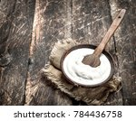 natural yogurt in a bowl. on a... | Shutterstock . vector #784436758