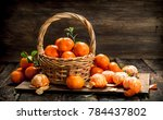 ripe tangerines in a basket. on ... | Shutterstock . vector #784437802