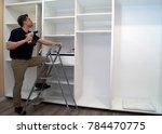 installation of big bedroom... | Shutterstock . vector #784470775