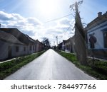 beautiful sunny road in a small ... | Shutterstock . vector #784497766