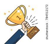 businessman hand holding gold... | Shutterstock .eps vector #784512172
