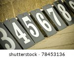 white numbers on black boards increasing in value - stock photo