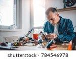 men wearing blue denim shirt... | Shutterstock . vector #784546978