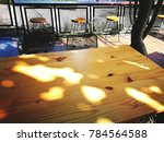 wood table and chair on outdoor ... | Shutterstock . vector #784564588
