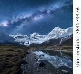milky way and high mountains.... | Shutterstock . vector #784574476