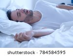 man snoring because of sleep... | Shutterstock . vector #784584595