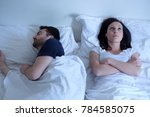 sad and thoughtful woman awake... | Shutterstock . vector #784585075