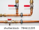 copper pipes and valves on a... | Shutterstock . vector #784611205