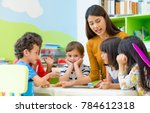 asian female teacher teaching... | Shutterstock . vector #784612318