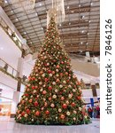 Giant Christmas tree in shopping mall - stock photo
