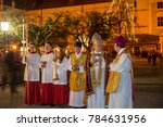 Small photo of Altoetting,Germany-Jan 1,2018: Priests talk before an open air mass to celebrate New Year begins