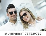 couple with sunglasses smiling... | Shutterstock . vector #784639792