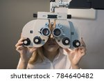 woman ready for eye test with... | Shutterstock . vector #784640482