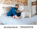 man relaxed at home sitting in... | Shutterstock . vector #784650958