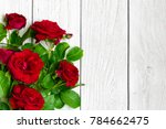 Stock photo red roses bouquet over white wooden table valentines day or womens day background top view with 784662475