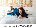 couple relaxed at home in bed... | Shutterstock . vector #784664038