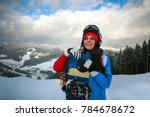 joyful woman snowboarder in... | Shutterstock . vector #784678672
