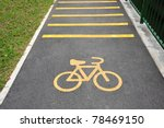 Bicycle Lane With Yellow Bicycle Sign On Tarmac - stock photo