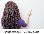 a girl with brown curly hair is ... | Shutterstock . vector #784695685