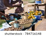 African Street Vendors Selling...