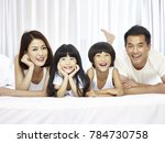 happy asian family with two... | Shutterstock . vector #784730758