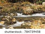 tinkling stream cascade   Shutterstock . vector #784739458