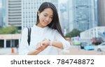 businesswoman look at the smart ...   Shutterstock . vector #784748872