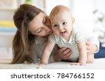 happy baby near to mom in... | Shutterstock . vector #784766152