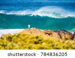 young man standing on rocks... | Shutterstock . vector #784836205