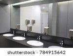 modern sinks with mirror in...   Shutterstock . vector #784915642