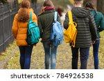 teenagers walking down street... | Shutterstock . vector #784926538