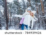 cheerful mother and little kid... | Shutterstock . vector #784939426