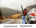 happy tourist travelling in... | Shutterstock . vector #784944955