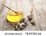 glass jar with honey and garlic