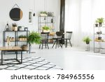wooden table on patterned... | Shutterstock . vector #784965556