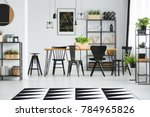 black chairs at table in... | Shutterstock . vector #784965826