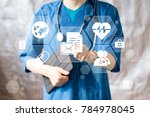 doctor pushing button file... | Shutterstock . vector #784978045