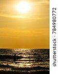 sandy beach  golden sea  sunset | Shutterstock . vector #784980772