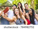 happy group of friends taking a ... | Shutterstock . vector #784982752
