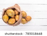 raw potatoes. on a white... | Shutterstock . vector #785018668