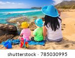 mother with twins on the beach... | Shutterstock . vector #785030995