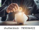 businessman put bitcoin to... | Shutterstock . vector #785036422